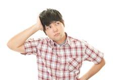 Uomo asiatico stanco Immagine Stock