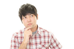 Uomo asiatico stanco Immagini Stock Libere da Diritti