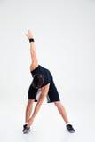Uomo atletico che fa allungando gli esercizi Immagine Stock