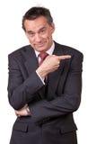 Uomo attraente di affari che indica a destra Fotografia Stock Libera da Diritti