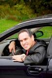 Uomo in automobile Immagini Stock