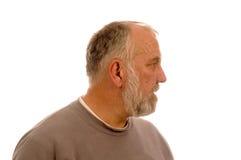 Uomo barbuto anziano nel profilo Fotografia Stock Libera da Diritti