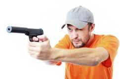 Uomo barbuto con una pistola Fotografia Stock
