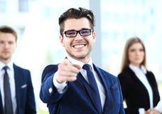 Uomo bello che indica il suo dito voi Fotografia Stock