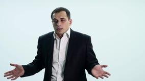 Uomo bello che mostra le emozioni differenti stock footage