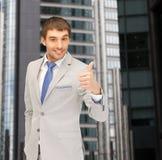 Uomo bello con i pollici su Fotografia Stock Libera da Diritti