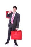 Uomo bello con i sacchetti di acquisto Fotografie Stock Libere da Diritti