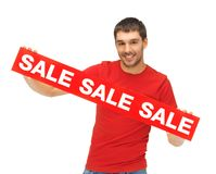 Uomo bello con il segno di vendita Immagini Stock Libere da Diritti