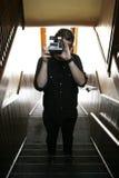 Uomo bello con la macchina fotografica di polaroid Fotografia Stock Libera da Diritti