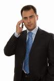 Uomo bello di affari che comunica sul telefono Fotografia Stock