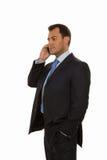 Uomo bello di affari che comunica sul telefono Fotografie Stock Libere da Diritti