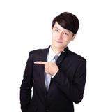 Uomo bello di affari che presenta a mano Fotografia Stock Libera da Diritti