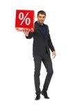 Uomo bello in vestito con il segno di percentuali Immagine Stock
