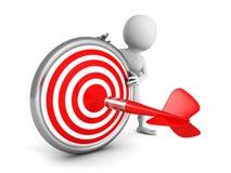 Uomo bianco 3d con l'obiettivo e la freccia rossi del dardo Fotografia Stock