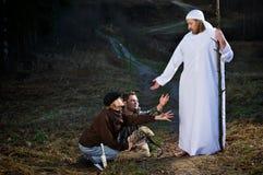Uomo biblico con i discepoli Fotografie Stock