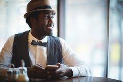 Uomo in caffè Fotografia Stock