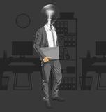 Uomo capo della lampada con il computer portatile Fotografia Stock Libera da Diritti