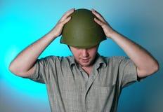 Uomo in casco Fotografia Stock