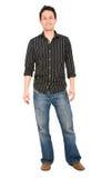 Uomo casuale che si leva in piedi sul bianco Immagini Stock Libere da Diritti