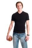 Uomo casuale con calcio Fotografie Stock Libere da Diritti