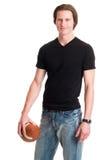 Uomo casuale con calcio Fotografia Stock