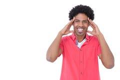 Uomo casuale emozionante con le mani sul fronte Fotografia Stock