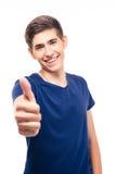 Uomo casuale felice che mostra pollice su Fotografia Stock