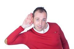 Uomo che ascolta qualcosa Fotografia Stock