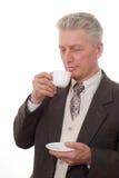 Uomo che beve da una tazza Immagini Stock Libere da Diritti