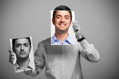 Uomo che cambia il suo umore fotografia stock