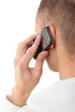 Uomo che comunica su un telefono mobile Immagini Stock Libere da Diritti