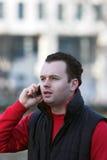 Uomo che comunica sul telefono Fotografia Stock Libera da Diritti
