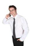 Uomo che comunica sul telefono delle cellule Immagine Stock Libera da Diritti