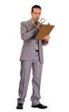 Uomo che controlla lista di controllo Immagine Stock Libera da Diritti