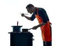 Uomo che cucina la siluetta del cuoco unico isolata Immagine Stock Libera da Diritti