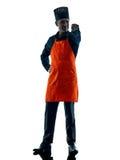 Uomo che cucina la siluetta del cuoco unico isolata Fotografia Stock
