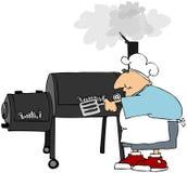 Uomo che cucina su una griglia del fumatore Immagine Stock Libera da Diritti