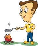 Uomo che cucina sul suo barbecue Fotografia Stock