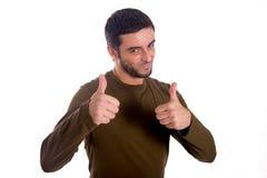 Uomo che dà i pollici su Immagine Stock