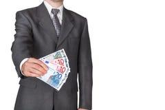 Uomo che dà le euro banconote Fotografia Stock Libera da Diritti