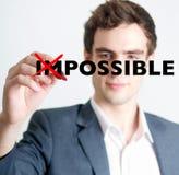 Uomo che depenna concetto impossibile Fotografia Stock Libera da Diritti