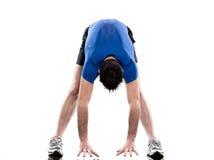 Uomo che esercita allungamento di forma fisica di allenamento Fotografia Stock