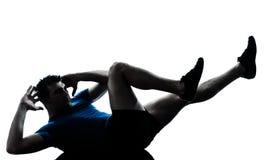 Uomo che esercita posizione di forma fisica di allenamento Fotografie Stock