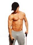 Uomo che fa esercizio di forma fisica Fotografia Stock