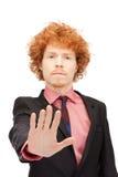 Uomo che fa gesto di arresto Immagini Stock