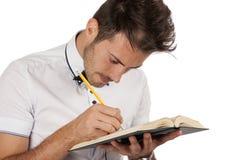 Uomo che fa le annotazioni Immagini Stock Libere da Diritti
