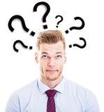 Uomo che fa le domande Immagine Stock