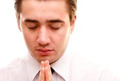 Uomo che fa una preghiera. Immagini Stock