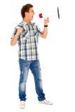 Uomo che grida tramite il megafono Immagine Stock