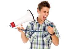 Uomo che grida tramite il megafono Immagini Stock